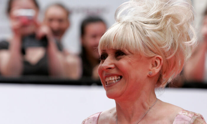Fans photograph actress Barbara Windsor as she arrives for the British Academy Television Awards at the Palladium theatre in London, on May 20, 2007. (Luke MacGregor/Reuters)
