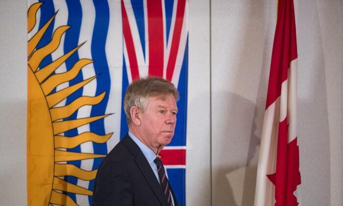Commissioner Austin Cullen looks over the hearing room before opening statements at the Cullen Commission of Inquiry into Money Laundering in British Columbia, in Vancouver, on Feb. 24, 2020. (The Canadian Press/Darryl Dyck)