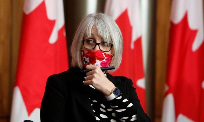 Health Minister Patty Hajdu arrives at a COVID-19 press conference in Ottawa, onDec. 11, 2020. (The Canadian Press/David Kawai)