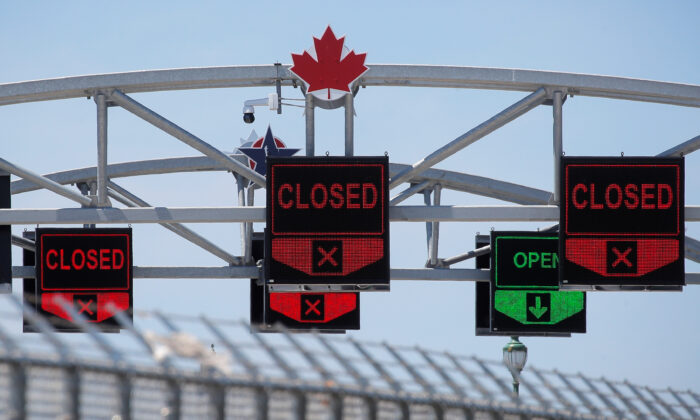A Canadian maple leaf is seen on The Peace Bridge, which runs between Canada and the United States, over the Niagara River in Buffalo, New York, U.S. on July 15, 2020. (Brendan McDermid/Reuters)