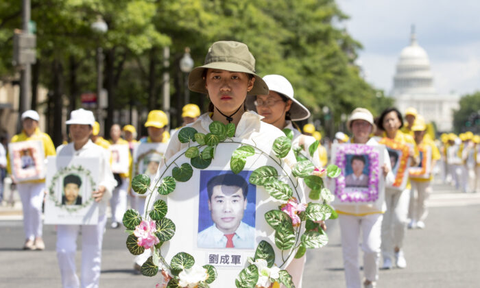 Falun Gong practitioners take part in a parade commemorating the 20th anniversary of the persecution of Falun Gong in China, in Washington on July 18, 2019. (Samira Bouaou/The Epoch Times)