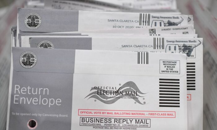 Mail-in ballots in their envelopes await processing at the Los Angeles County Registrar Recorders' processing center in Pomona, Calif., on Oct. 28, 2020. (Robyn Beck/AFP via Getty Images)