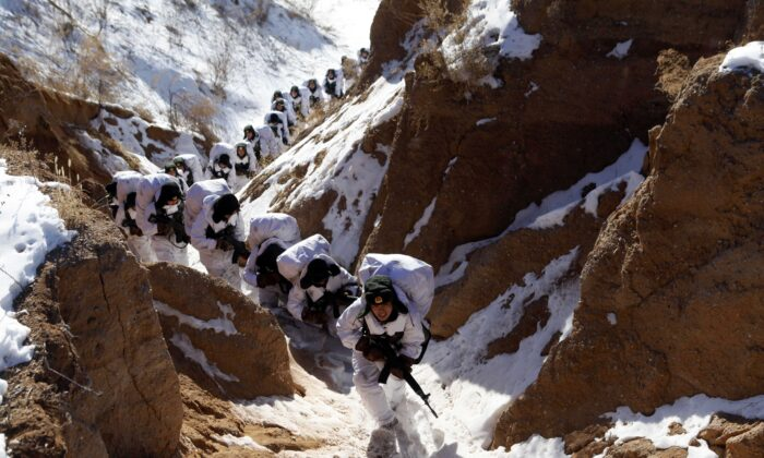 Chinese soldiers attending a winter training session in Heihe, northeast China's Heilongjiang province on Jan. 28, 2015 (STR/AFP via Getty Images)