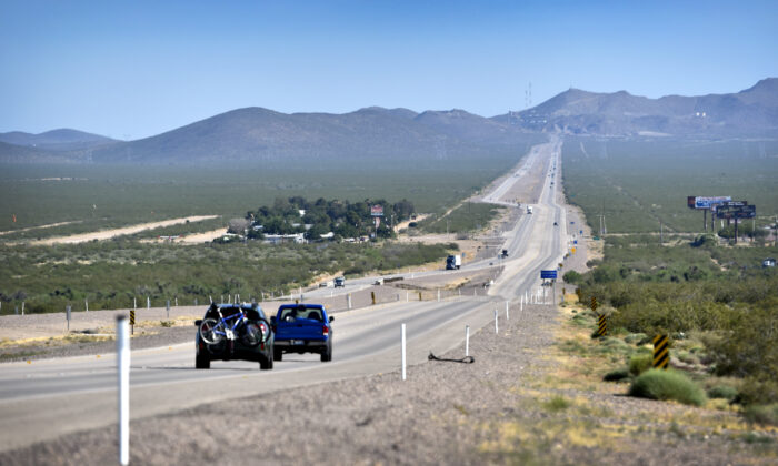 Motorists travel along U.S. Highway 95 near the town of Cal-Nev-Ari, Nev. on May 15, 2016. (David Becker/AFP via Getty Images)