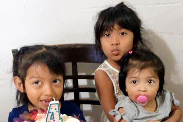 The children of Henry Eduardo Saldana-Mejia and Gabriela M. Andrade celebrate a birthday days before their parents were killed in a car crash in Santa Ana, Calif. (Courtesy of Maria Corrigan)