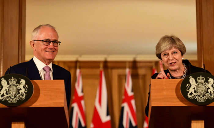 Australia's then Prime Minister Malcolm Turnbull and his British counterpart Theresa May speak at a press conference in 10 Downing Street in central London, on July 10, 2017. (Hannah Mckay/AFP via Getty Images)