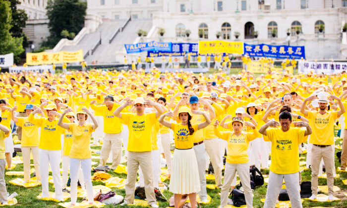 Falun Gong practitioners take part in a rally calling for an end to the persecution of Falun Gong in China, on Capitol Hill in Washington, on June 20, 2018. (Edward Dye/The Epoch Times)