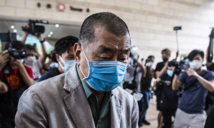 Hong Kong pro-democracy media mogul Jimmy Lai pushes through a media pack as he arrives at the West Kowloon court in Hong Kong on Sept. 3, 2020. (Isaac Lawrence/AFP via Getty Images)