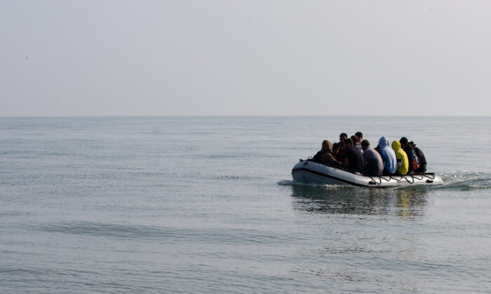 Migrants land on Deal beach after crossing the English channel from France in a dinghy, in Deal, England, on Sept. 14, 2020. (Luke Dray/Getty Images)