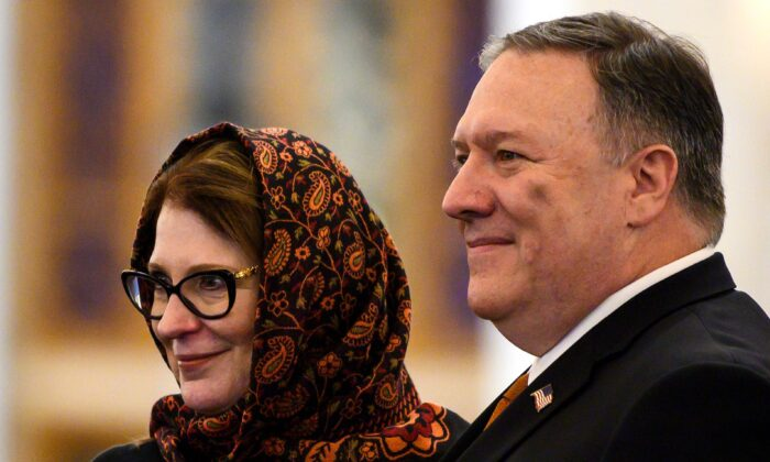 U.S. Secretary of State Mike Pompeo (R) and his wife Susan pose for a photo as they take a tour of the newly-inaugrated Al-Fattah Al-Alim mosque in Egypt's New Administrative Capital, 45 kilometres (28 miles) east of Cairo on Jan. 10, 2019. (Andrew Caballero-Reynolds/AFP via Getty Images)
