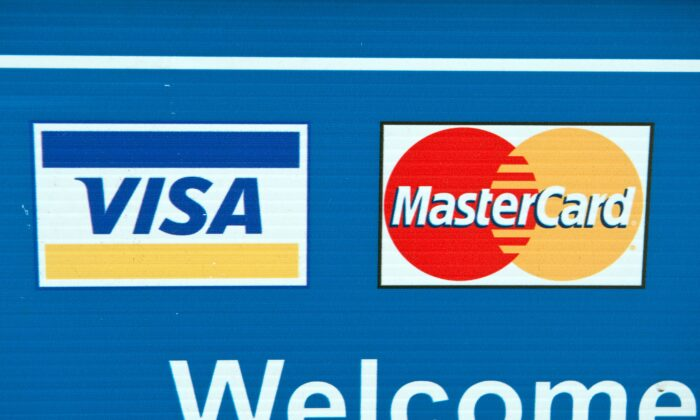 Visa and MasterCard credit card logos are seen on a sign in Washington on March 30, 2012. (Nicholas Kamm/AFP via Getty Images)