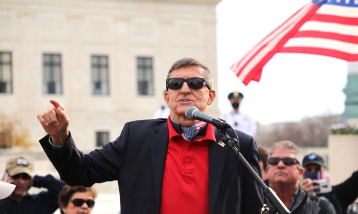 Retired Lt. Gen. Mike Flynn speaks among President Donald Trump supporters who rally in Washington on Dec. 12, 2020. (Yong Wang/The Epoch Times)