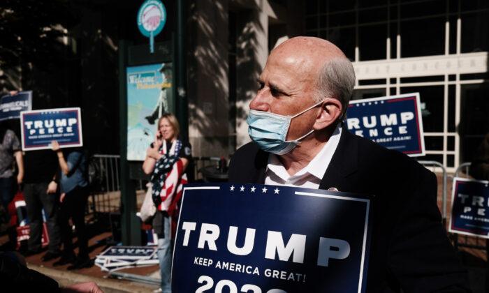 Rep. Louie Gohmert (R-Texas) holds a Trump 2020 sign outside of the Pennsylvania Convention Center in Philadelphia, on Nov. 06, 2020. (Spencer Platt/Getty Images)
