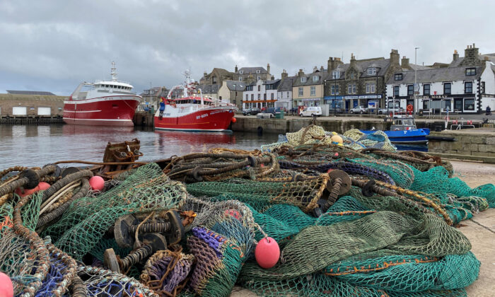 View of fishing boats and a net in the coastal town of Macduff, Aberdeenshire, Scotland, on Oct. 18, 2020. (Alexander Smith/Reuters)