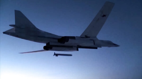 A Russian Tu-160 strategic bomber fires a cruise missile