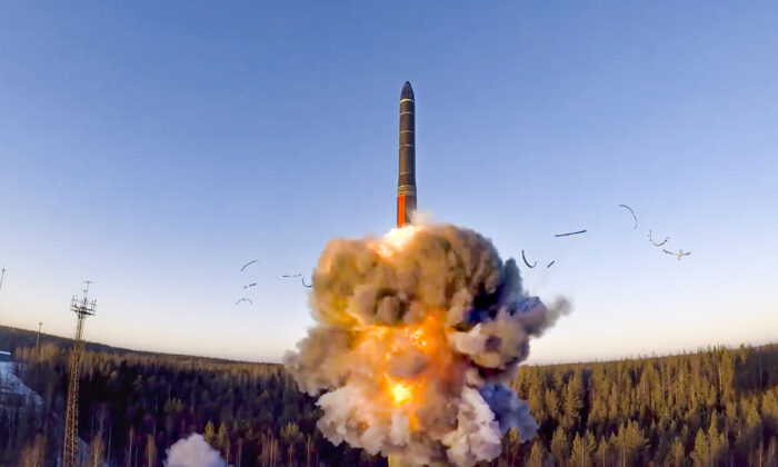 A Russian rocket launches from a missile system as part of the drills, a ground-based intercontinental ballistic missile was launched from the Plesetsk facility in northwestern Russia, on Dec. 9, 2020. (Russian Defense Ministry Press Service via AP)