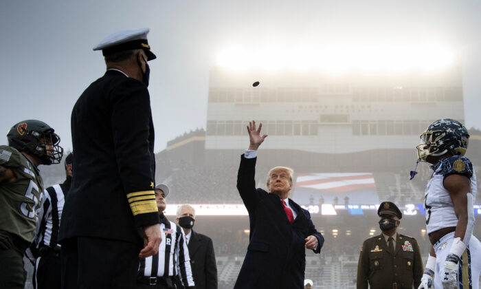 President Donald Trump tosses the coin before the Army-Navy football game at Michie Stadium in West Point, N.Y., on Dec. 12, 2020. (Brendan Smialowski/AFP via Getty Images)
