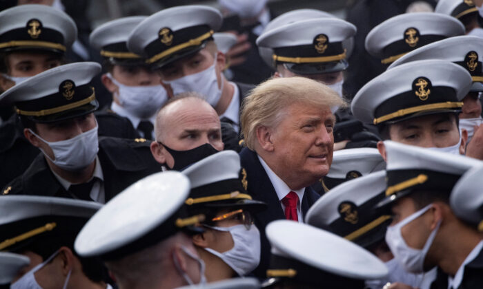 President Donald Trump poses with Navy Academy cadets during Army-Navy football game at Michie Stadium in West Point, N.Y., on Dec. 12, 2020. (Brendan Smialowski/AFP via Getty Images)
