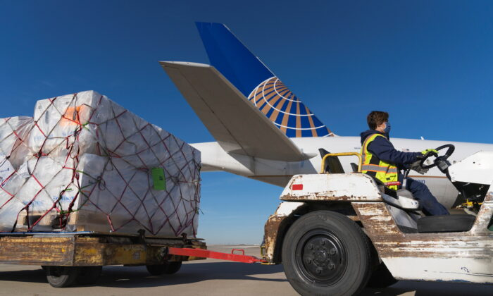 A shipment of Pfizer's COVID-19 vaccines is unloaded from a United Airlines cargo-only flight from Brussels to O'Hare International Airport in Chicago, on Dec. 2, 2020. (United Airlines via Reuters)