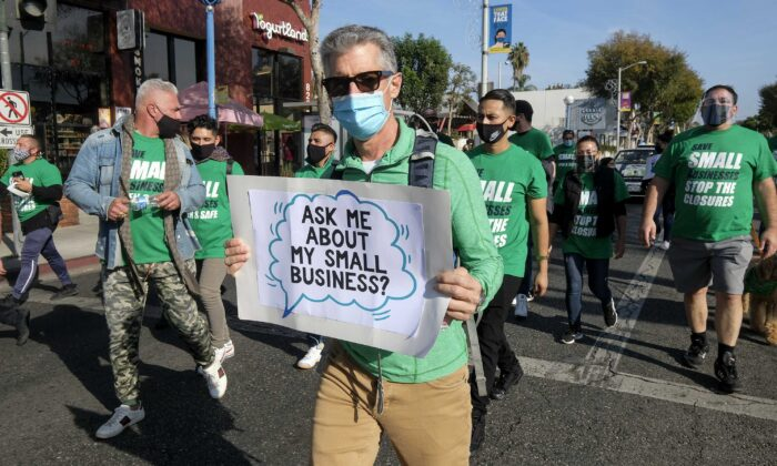"Members of small business owners take part in a ""Save Small Business"" protest in Los Angeles, on Dec. 12, 2020. (Ringo Chiu/AFP via Getty Images)"