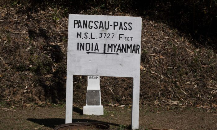 A sign on the border between Burma (also known as Myanmar) and India at Pangsau Pass, Saigang state, northern Burma, on Feb. 19, 2014. (Findlay Kember/AFP via Getty Images)