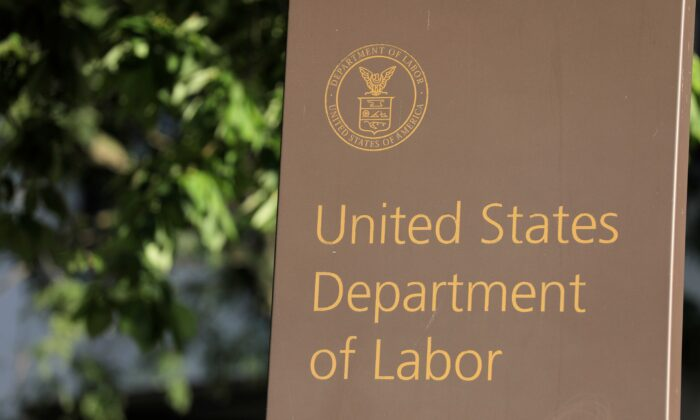 Signage is seen at the U.S. Department of Labor headquarters in Washington on Aug. 29, 2020. (Andrew Kelly/Reuters)