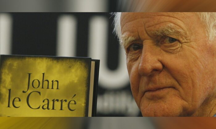 British author John le Carre holds a copy of his new book entitled 'Our Kind of Traitor' at a central London bookstore during a book signing event to mark the launch of the novel in London, on Sept. 16, 2010. John le Carre, the spy-turned-novelist, has died aged 89. (Alastair Grant/AP Photo)