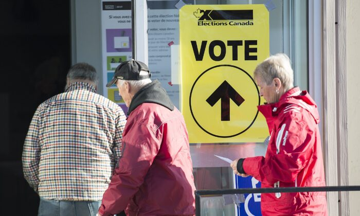 People arrive to cast their ballots on federal election day at a polling station in Shawinigan, Que., on Oct. 21, 2019. (The Canadian Press/Graham Hughes)
