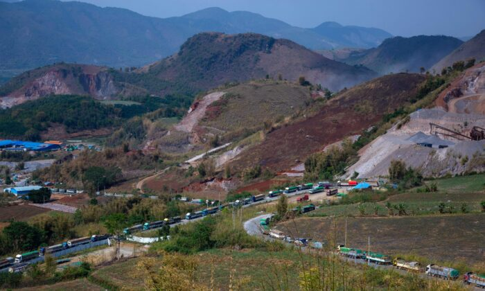 Food trucks wait to enter China near Muse, close to the Chinese border in Shan state, Myanmar on April 20, 2020. (Phyo Maung/AFP via Getty Images)