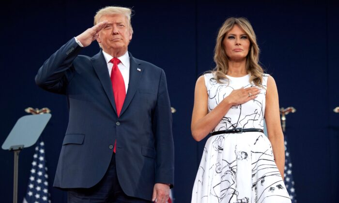 President Donald Trump and First Lady Melania Trump pay their respects as they listen to the national anthem during the Independence Day events at Mount Rushmore National Memorial in Keystone, S.D., on July 3, 2020. (Saul Loeb/AFP via Getty Images)