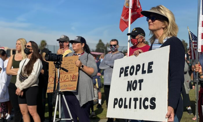 Protesters call for the opening of businesses in Newport Beach, Calif., on Dec. 13, 2020. (Jamie Joseph/The Epoch Times)