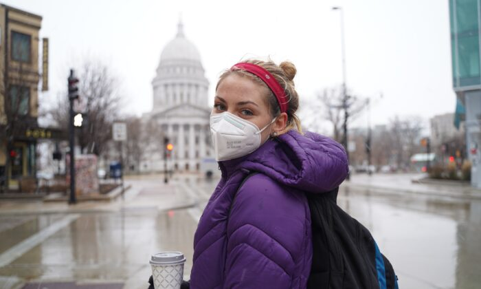 Samantha Armstrong stands in front of Wisconsin's Capitol building in downtown Madison, on Dec. 11, 2020. (Cara Ding/The Epoch Times)