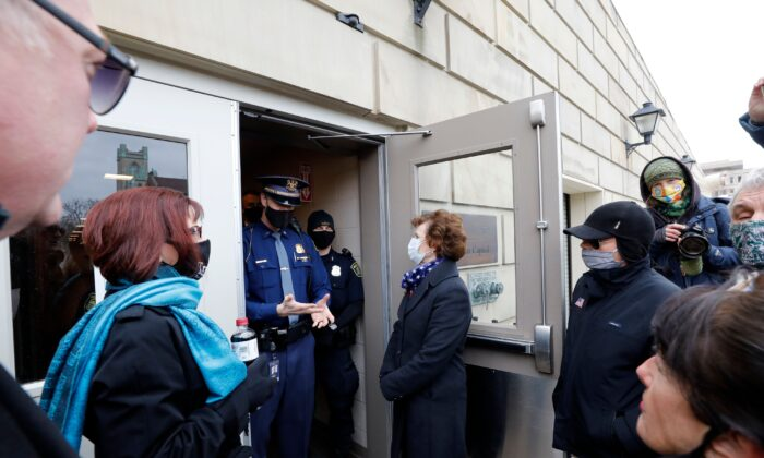 Electors from the GOP are denied entry to the Michigan Capital as the Electors from the Democratic Party cast their ballot in Lansing, Mich., on Dec. 14, 2020. (Jeff Kowalsky/AFP via Getty Images)