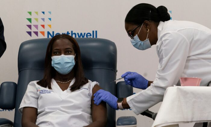 Sandra Lindsay, a nurse at Long Island Jewish Medical Center, is inoculated with the COVID-19 vaccine from Pfizer and BioNTech, at Long Island Jewish Medical Center in New Hyde Park, N.Y., on Dec. 14, 2020. (Mark Lennihan/Pool via Reuters)