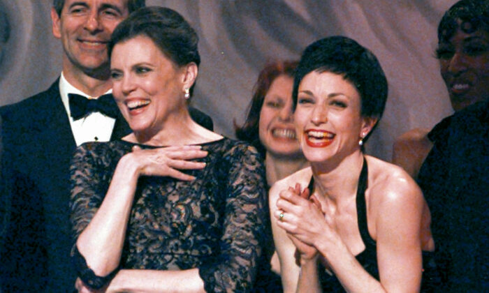 "Ann Reinking (L) and Bebe Neuwirth share a laugh on stage while accepting the award for best revival of ""Chicago"" during the 51st Annual Tony Awards in New York City on June 1, 1997. (Adam Nadel/AP Photo)"
