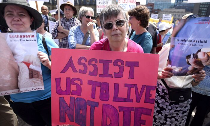 People rally against Bill C-14, the medically assisted dying bill, during a protest in Ottawa on June 1, 2016. Bill C-7, currently before the Senate, seeks to broaden the 2016 law on medical assistance in dying. (The Canadian Press/Justin Tang)