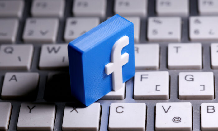 A 3D-printed Facebook logo is seen placed on a keyboard on March 25, 2020. (Dado Ruvic/Reuters)