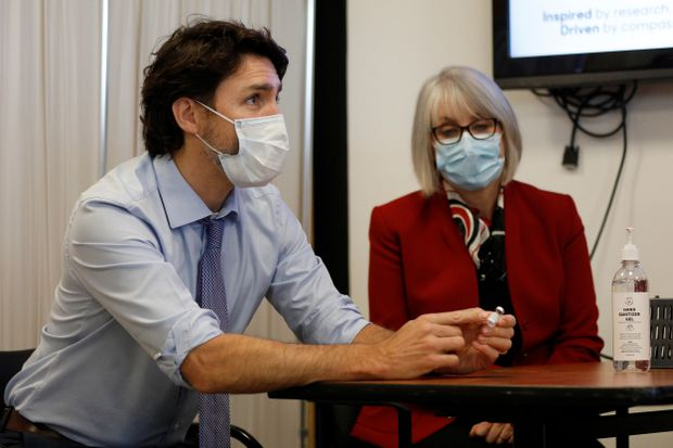 Prime Minister Justin Trudeau and Health Minister Patty Hajdu at the Civic Hospital in Ottawa, on Dec. 15, 2020. (Reuters/Blair Gable)