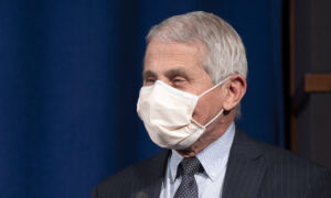 Fauci Says It's 'Possible' Americans Still Need to Wear Masks in 2022