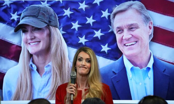Sen. Kelly Loeffler (R-Ga.) speaks in front of a picture of her and Sen. David Perdue (R-Ga.) at a campaign event at the Cobb County Republican Party Headquarters in Marietta, Ga., on Nov. 11, 2020. (Elijah Nouvelage/Reuters)