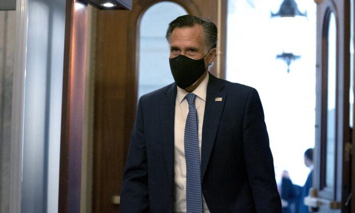 Sen. Mitt Romney (R-Utah) walks at the U.S. Capitol in Washington on Dec. 11, 2020. (Stefani Reynolds/Getty Images)