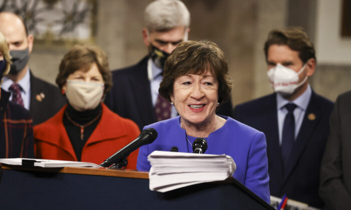 Sen. Susan Collins (R-Maine) speaks alongside a bipartisan group of Democrat and Republican members of Congress as they announce a proposal for a COVID-19 relief bill, on Capitol Hill in Washington on Dec. 14, 2020. (Tasos Katopodis/Getty Images)