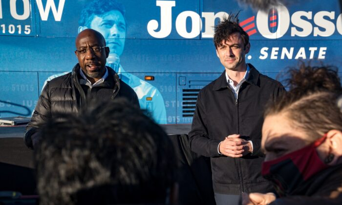 Democratic Georgia Senate candidates Rev. Raphael Warnock (L) and Jon Ossoff address supporters during a rally in Atlanta, Ga., on Dec. 14, 2020. (Megan Varner/Getty Images)