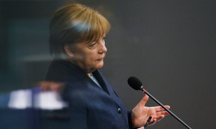 German Chancellor Angela Merkel answers questions of lawmaker about German government's policy at the parliament Bundestag, in Berlin, Germany, on Dec. 16, 2020. (Markus Schreiber/AP Photo)