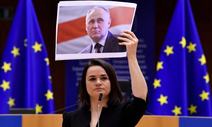 Belarusian opposition politician Sviatlana Tsikhanouskaya holds a picture of Belarusian politician Mikalai Statkevich as she gives a speech during the Sakharov Prize ceremony at the European Parliament in Brussels on Dec. 16, 2020. (John Thys/Pool Photo via AP)