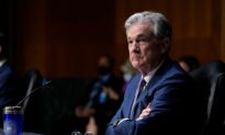 Fed Holds Interest Rates Near Zero, Raises Economic Outlook