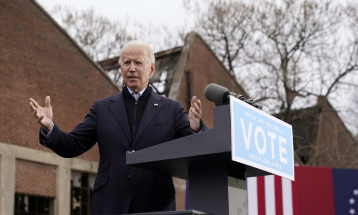 Democratic presidential nominee Joe Biden speaks at a drive-in rally for Democratic candidates for U.S. Senate Raphael Warnock and Jon Ossoff, in Atlanta, Ga., on Dec. 15, 2020. (Patrick Semansky/AP Photo)