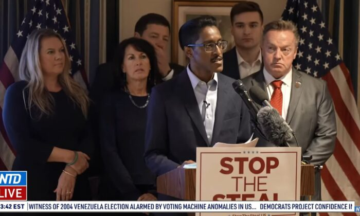 """Ali Alexander, director of the """"Stop the Steal"""" movement, speaks during a press conference in Washington on Dec. 15, 2020. Among those with him are Michigan GOP electors Meshawn Maddock and Marian Sheridan. (NTD Television)"""