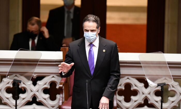 New York Gov. Andrew Cuomo speaks to members of New York state's Electoral College before voting for president and vice president in the Assembly Chamber at the state Capitol in Albany, New York, on Dec. 14, 2020. (Hans Pennink/POOL/AFP via Getty Images)