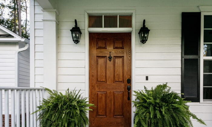 It can actually be more work to install a new door instead of a prehung one, but it will save you some money if you don't count your time. (Ursula Page/Shutterstock)